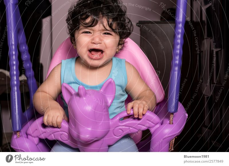 Crying little baby girl on unicorn swing Lifestyle Beautiful Playing Children's game Living or residing Flat (apartment) House (Residential Structure) Room