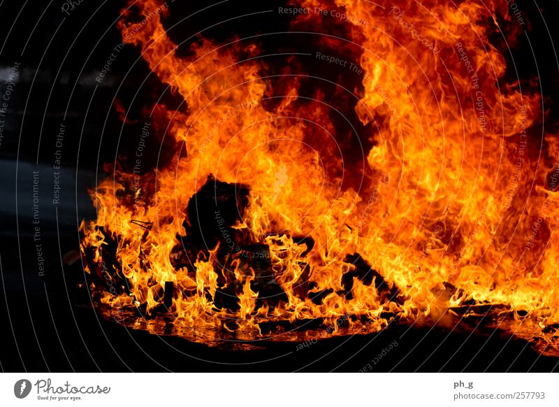 Put out the fire on us Smoke Aggression Esthetic Threat Dark Authentic Hot Warmth Yellow Red Fire Blaze Trash container Burn burning Colour photo Exterior shot