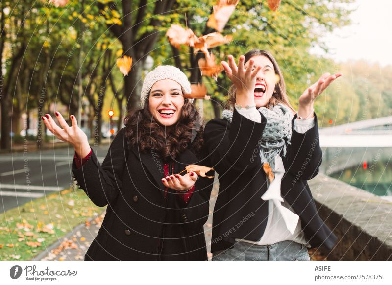 Girls crazy for autumn Lifestyle Joy Happy Beautiful Woman Adults Friendship Youth (Young adults) Autumn Leaf Fashion Scarf Smiling Laughter Cool (slang)