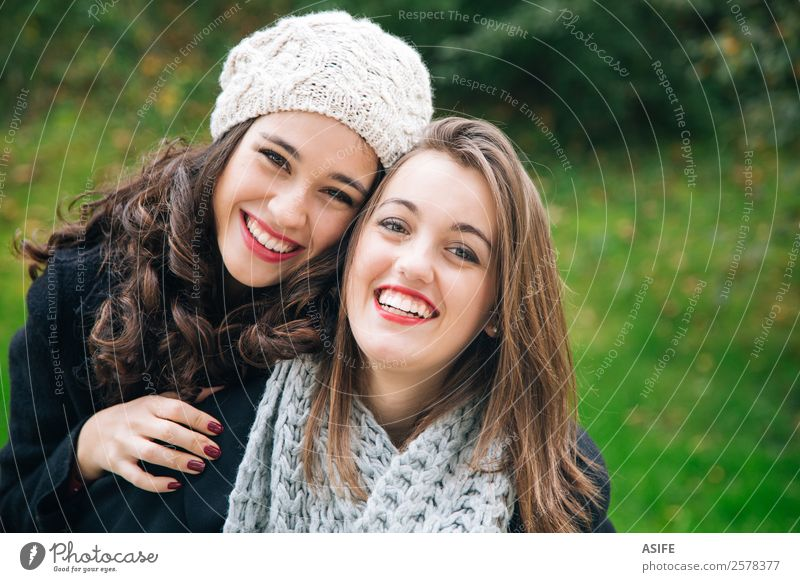 Best friends portrait Lifestyle Joy Happy Beautiful Winter Woman Adults Friendship Youth (Young adults) Autumn Park Fashion Scarf Smiling Laughter Love Embrace
