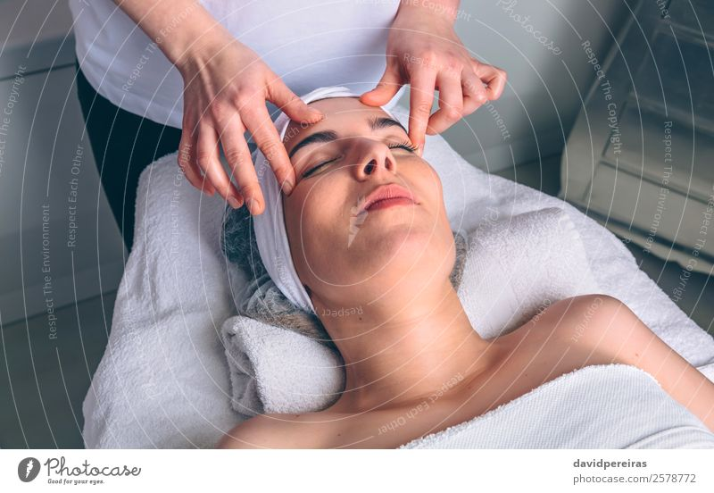 Woman receiving facial treatment on clinical center Human being Beautiful Hand Relaxation Face Adults Natural Health care Happy Body Authentic Skin Wellness