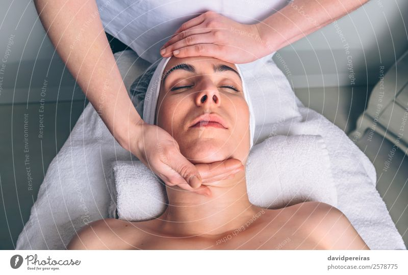 Woman receiving facial treatment on clinical center Human being Beautiful Hand Relaxation Face Adults Health care Happy Body Authentic Skin Wellness