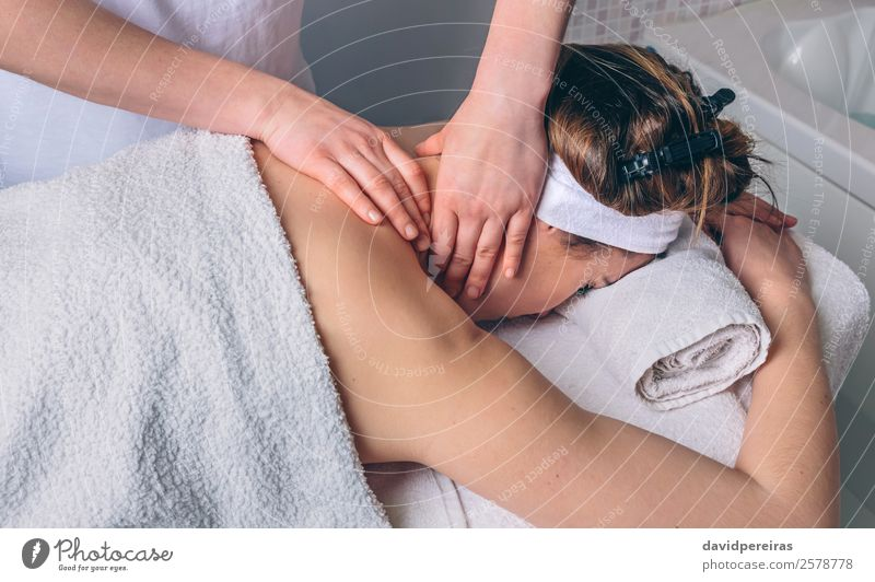 Woman receiving massage on neck in clinical center Human being Beautiful Hand Relaxation Adults Natural Health care Happy Body Lie Authentic Skin Wellness