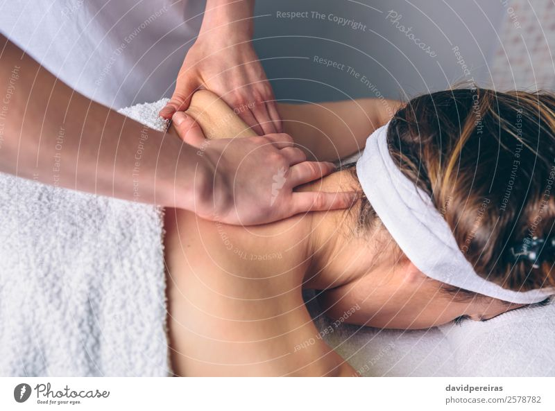 Woman receiving massage on shoulders in clinical center Happy Beautiful Body Skin Health care Medical treatment Medication Wellness Relaxation Spa Massage