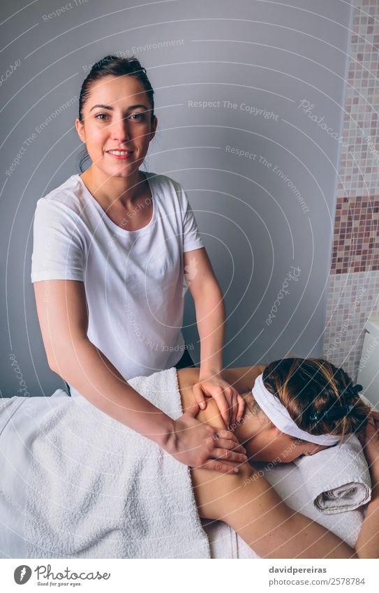 Female massage therapist doing treatment to woman in clinic Happy Beautiful Body Skin Health care Medical treatment Medication Wellness Relaxation Spa Massage