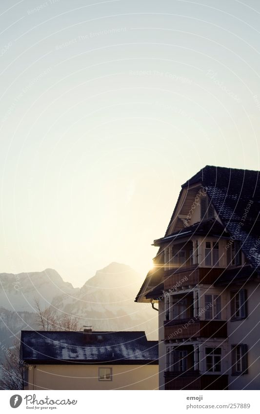 winter sun Sky Cloudless sky Winter Beautiful weather Mountain Village House (Residential Structure) Cold Winter sun Colour photo Exterior shot Deserted