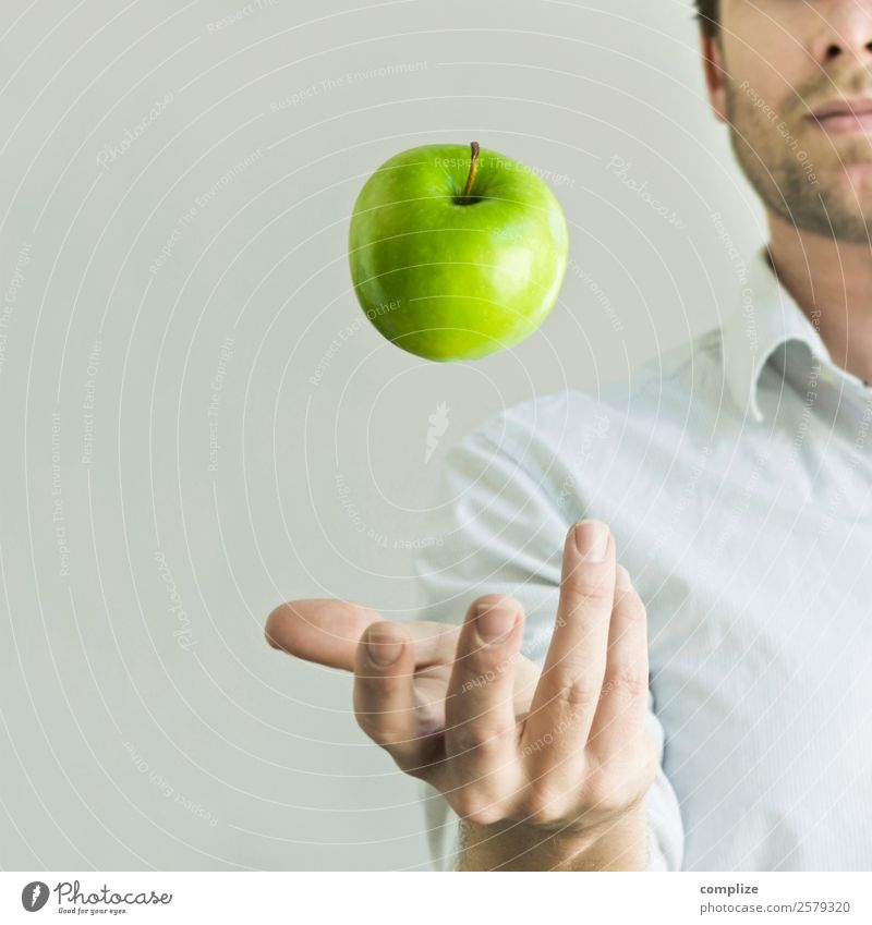 Man juggling with a green apple Food Fruit Apple Nutrition Eating Breakfast Picnic Organic produce Vegetarian diet Diet Joy Happy Healthy Health care