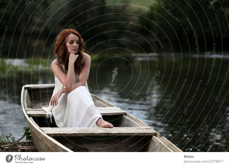 Young woman in the boat Portrait photograph Youth (Young adults) Girl Woman Sit Watercraft Attractive Beautiful Beauty Photography Dramatic Adults Human being