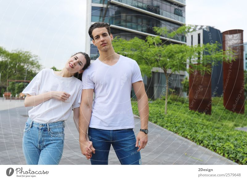 Young beautiful couple posing wearing jeans and t-shirt Woman Human being Youth (Young adults) Man Beautiful Eroticism Black Lifestyle Adults Love Happy Style