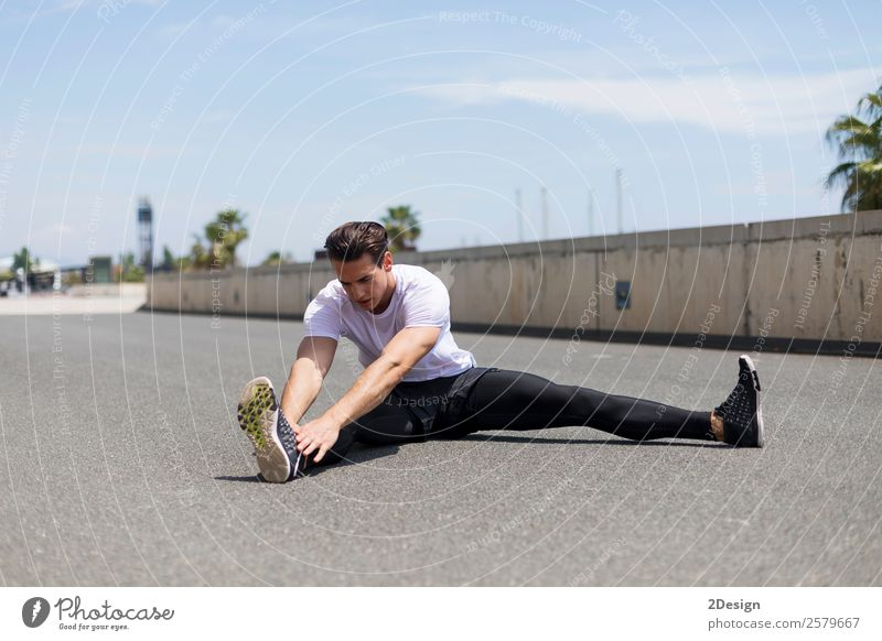 Muscular man stretching outdoors Lifestyle Body Healthy Health care Relaxation Summer Sports Fitness Sports Training Track and Field Human being Masculine