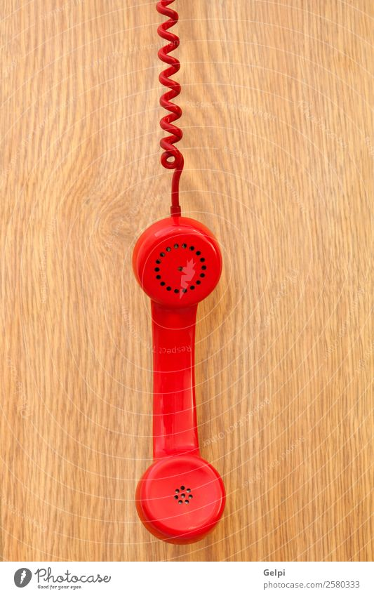 Old red phone Office Telecommunications Business Telephone Wood Plastic Line Listening Communicate To call someone (telephone) Retro Brown Red Colour Contact