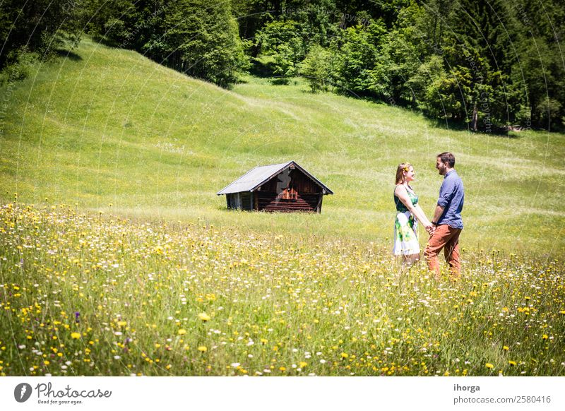 happy lovers on Holiday in the alps mountains Lifestyle Happy Beautiful Relaxation Vacation & Travel Adventure Summer Mountain Woman Adults Man Couple Partner