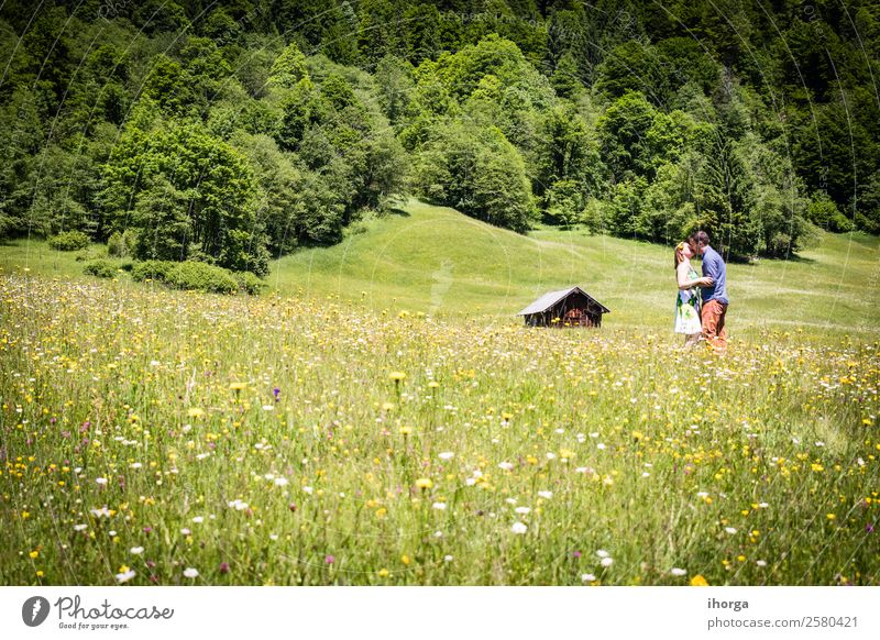 happy lovers on Holiday in the alps mountains adventure background beautiful cheerful countryside couple europe female field flower forest girl green hands