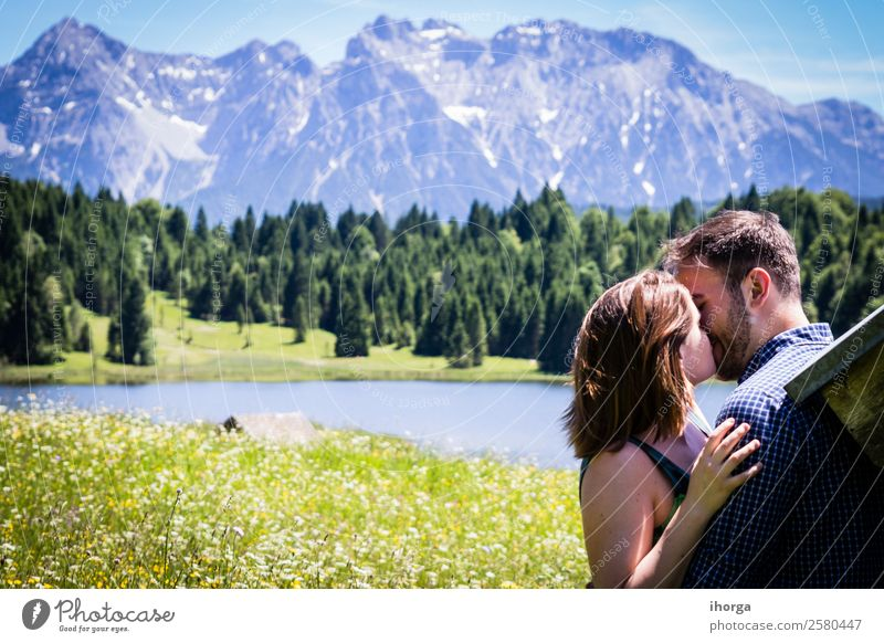 Two happy lovers on Holiday in the alps mountains Woman Human being Sky Vacation & Travel Nature Man Summer Beautiful Green Landscape Flower Relaxation Forest