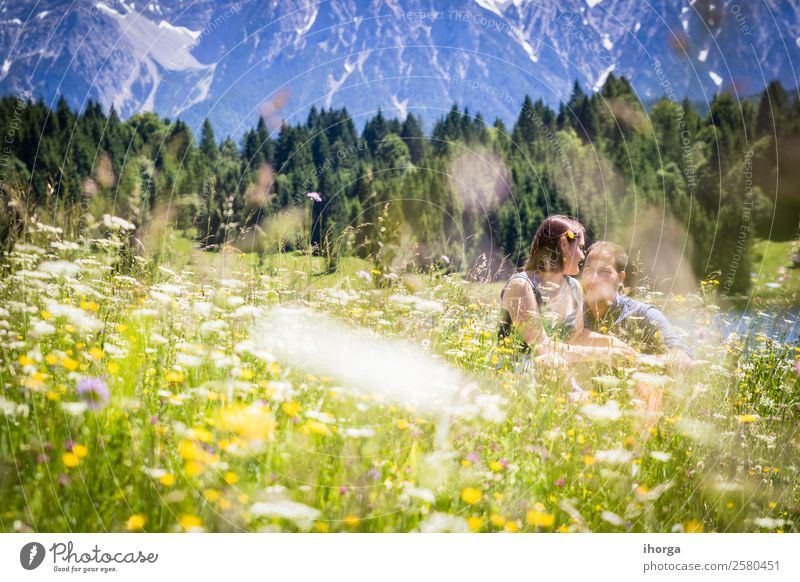 happy lovers on Holiday in the alps mountains Woman Human being Vacation & Travel Nature Youth (Young adults) Man Summer Beautiful Green Landscape Flower