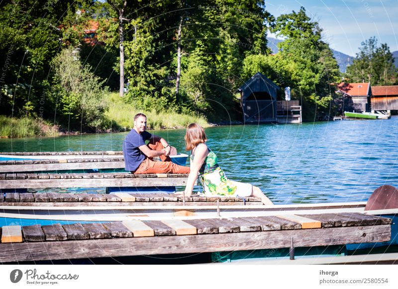 Two happy lovers on vacation at the pier on a lake Lifestyle Happy Beautiful Relaxation Vacation & Travel Adventure Summer Mountain Woman Adults Man Couple