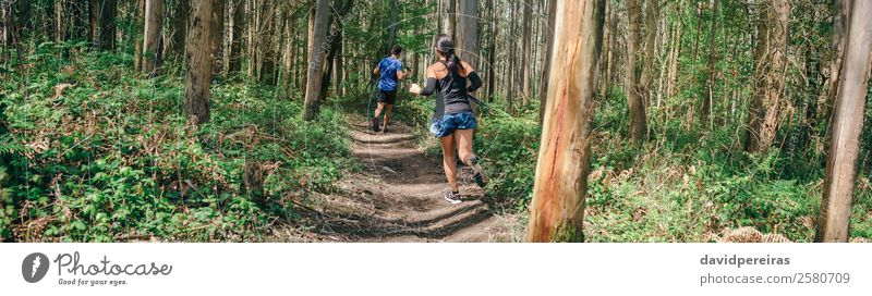 Young woman and man doing trail Lifestyle Adventure Sports Human being Woman Adults Man Couple Nature Tree Forest Lanes & trails Fitness Authentic Speed Effort