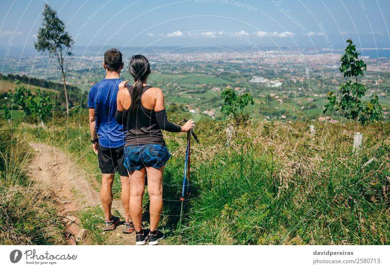 Couple stopping to look the views while doing trail Lifestyle Adventure Sports Human being Woman Adults Man Nature Tree Forest Lanes & trails Observe Stand