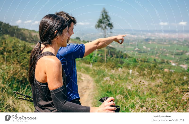 Couple stopping to look the views while doing trail Lifestyle Happy Adventure Sports Human being Woman Adults Man Nature Landscape Tree Lanes & trails Observe