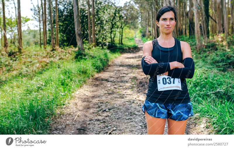 Female trail athlete posing with race number Lifestyle Beautiful Sports Human being Woman Adults Nature Tree Forest Lanes & trails Authentic Self-confident