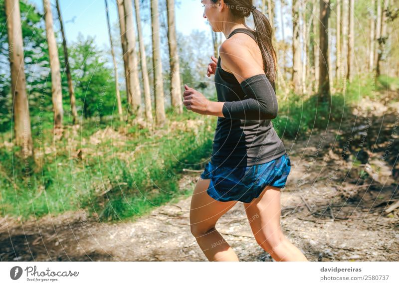 Young woman doing trail Lifestyle Adventure Sports Human being Woman Adults Nature Tree Forest Lanes & trails Sneakers Fitness Authentic Speed Effort Energy