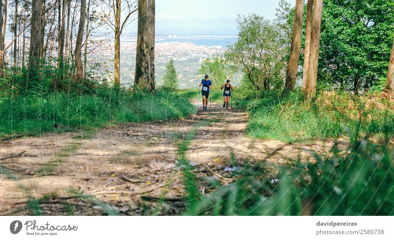 Young woman and man doing trail Lifestyle Mountain Sports Human being Woman Adults Man Couple Nature Landscape Tree Forest Lanes & trails Authentic Speed Effort