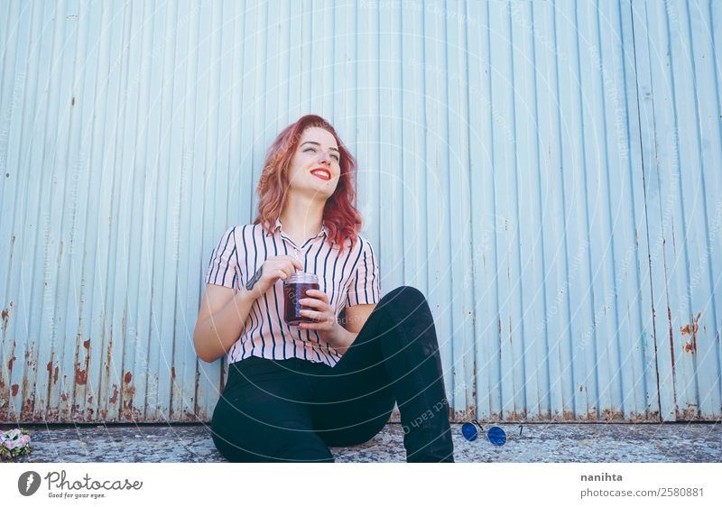 Young happy woman against a blue wall Beverage Cold drink Tea Lifestyle Joy Wellness Well-being Leisure and hobbies Human being Feminine Young woman