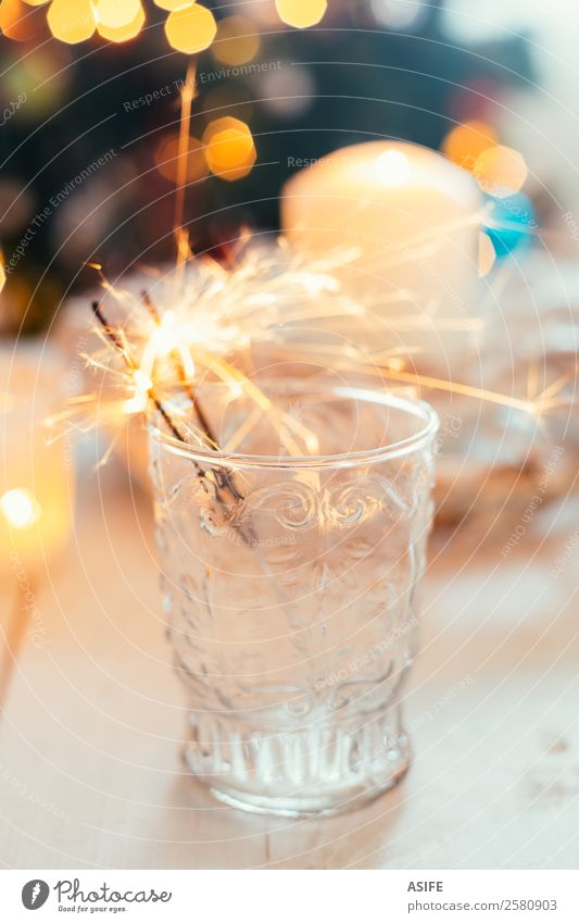 Sparklers in a glass Joy Decoration Feasts & Celebrations Christmas & Advent New Year's Eve Warmth Tree Candle Happiness White bokeh. table Ornaments lighting