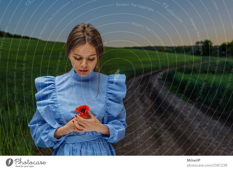 Looking at red poppy. Woman Human being Sky Nature Youth (Young adults) Young woman Blue Plant Green Red Flower Street Adults Fashion Europe Stand