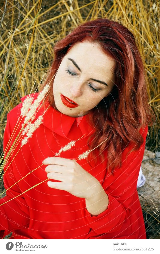 Young woman in nature wearing a red dress Woman Human being Nature Youth (Young adults) Plant Beautiful Red 18 - 30 years Face Lifestyle Adults Autumn Yellow