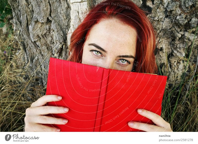 Young redhead woman cover by a book Woman Human being Youth (Young adults) Young woman Beautiful Red 18 - 30 years Lifestyle Adults Autumn Feminine Style Design