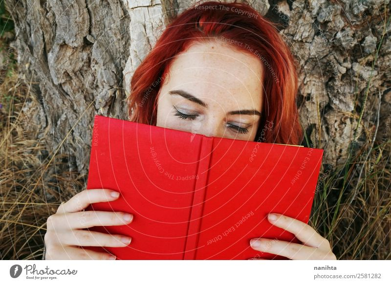 Young redhead woman covered by a book Woman Human being Nature Youth (Young adults) Young woman Beautiful Red 18 - 30 years Lifestyle Adults Wood Natural
