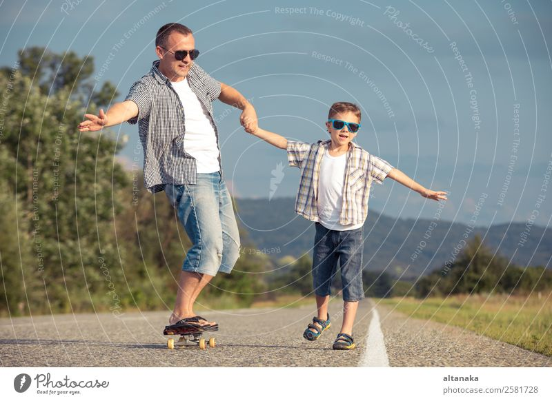 Father and son playing on the road Lifestyle Joy Happy Leisure and hobbies Playing Vacation & Travel Trip Adventure Freedom Camping Summer Mountain Sports Child