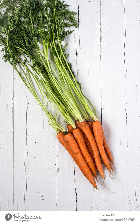 Fresh carrots on a white background Nature Green White Eating Food Wood Natural Copy Space Orange Above Nutrition Delicious Vegetable Vegetarian diet Diet
