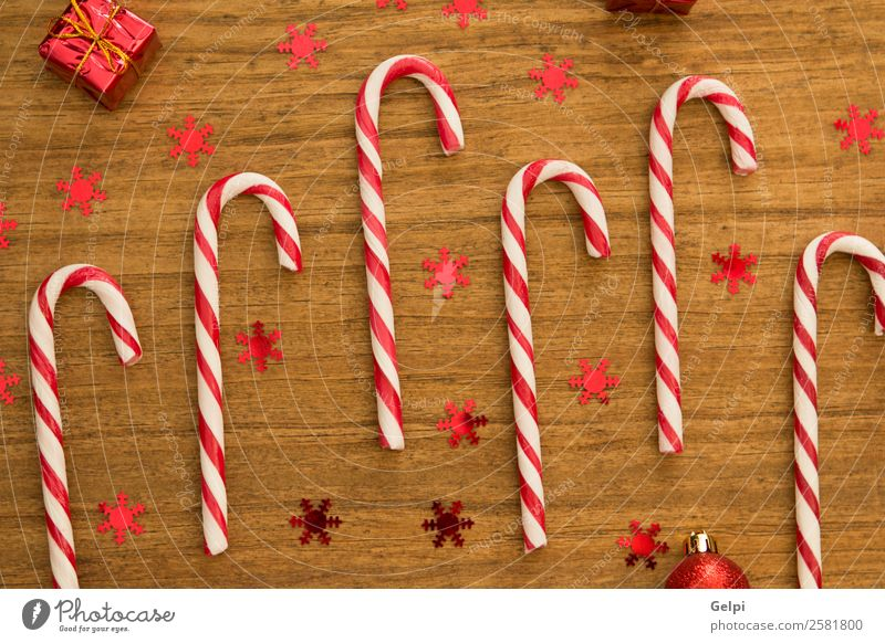 Candy canes with Christmas balls Dessert Design Joy Happy Winter Decoration Feasts & Celebrations Christmas & Advent Wood Ornament Stripe Bright Red White