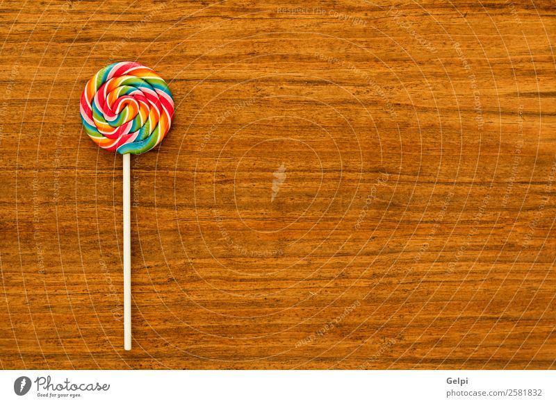 Nice lollipop Dessert Eating Joy Infancy Wood Delicious Retro Red White Colour candy food Lollipop sweet lolly Sugar colorful stick background Unhealthy Tasty
