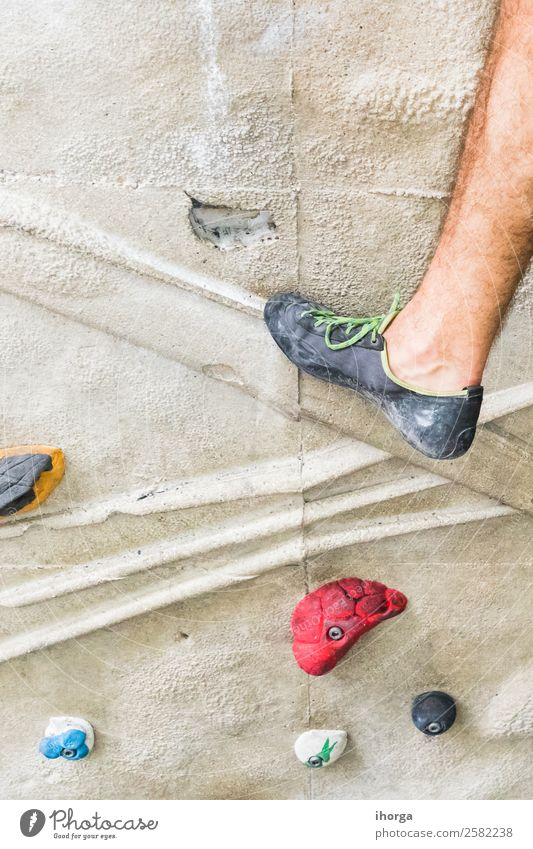 A Man practicing rock climbing on artificial wall indoors. Lifestyle Joy Leisure and hobbies Sports Climbing Mountaineering Adults Legs Feet 18 - 30 years
