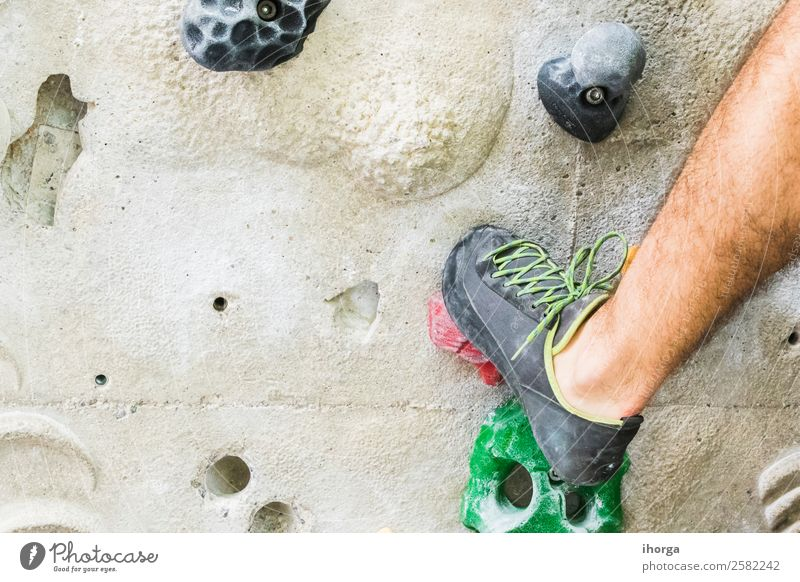 A Man practicing rock climbing on artificial wall indoors. Lifestyle Joy Leisure and hobbies Sports Climbing Mountaineering Adults Legs Feet 1 Human being