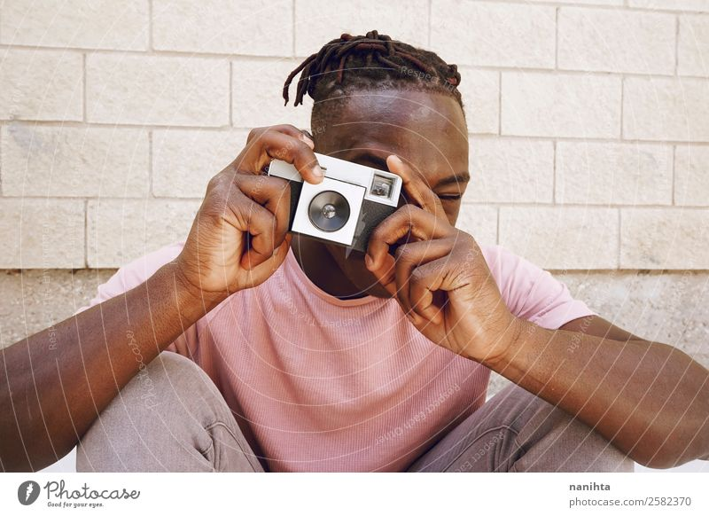 Young man taking shots with a camera Lifestyle Style Design Leisure and hobbies Work and employment Profession Camera Technology Entertainment electronics