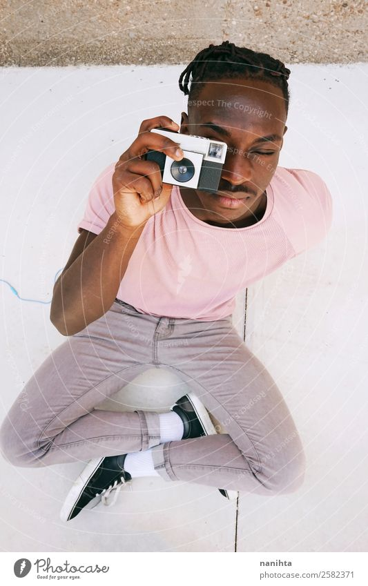 Young man taking photos Human being Youth (Young adults) Man Town Black 18 - 30 years Lifestyle Adults Style Art Work and employment Design Leisure and hobbies