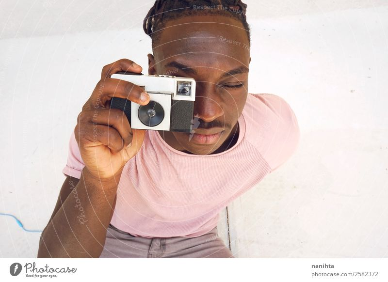Young man taking a shot with an old camera Lifestyle Style Design Leisure and hobbies Camera Human being Masculine Youth (Young adults) Man Adults 1