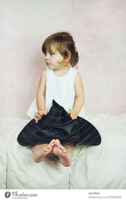 Studio portrait of a little girl Style Carnival Hallowe'en Human being Feminine Child Toddler Girl Infancy 1 1 - 3 years Dress Hat Brunette Blonde Long-haired