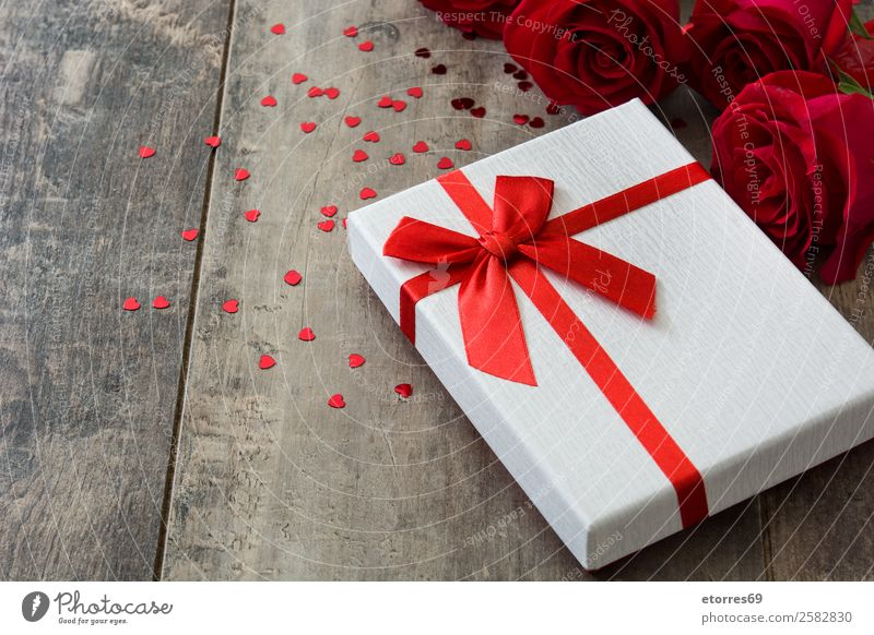 Gift box and red rose on wooden background.Valentines concept Vacation & Travel Flower Wood Love Feasts & Celebrations Birthday String Rose Surprise
