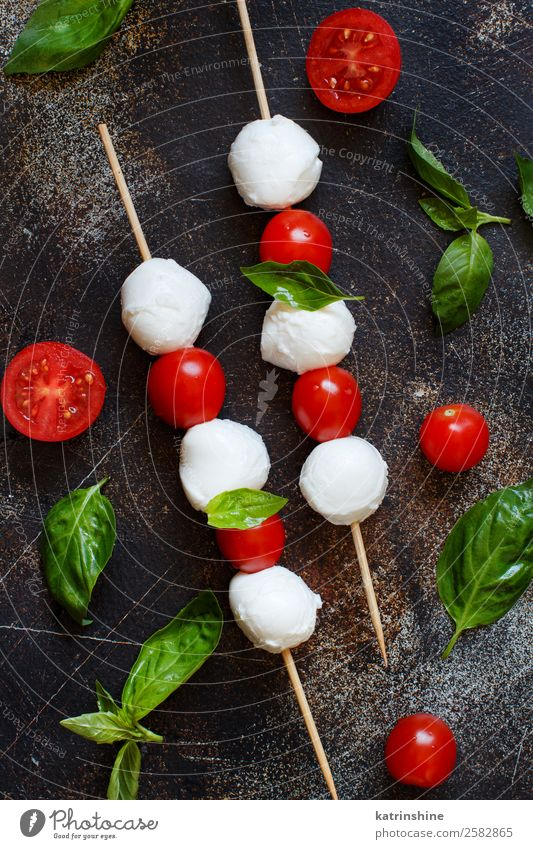 Italian cheese mozzarella with tomatoes, basil and olive oil Nutrition Vegetarian diet Ball Dark Fresh Bright Delicious Soft Green Red White Tradition Meal