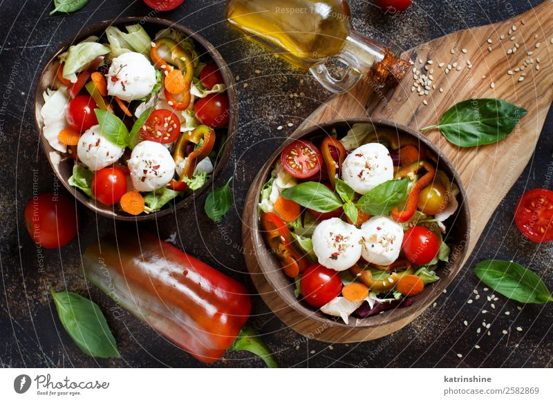 Mixed salad with mozzarella Cheese Vegetable Herbs and spices Eating Lunch Vegetarian diet Diet Bottle Leaf Dark Fresh Green Red appetizer Basil Caprese Cherry