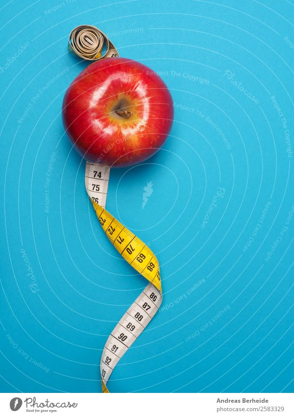 Apple with measuring tape, counting calories, Christmas, diet, losing weight Food Fruit Organic produce Vegetarian diet Diet Fasting Lifestyle Healthy