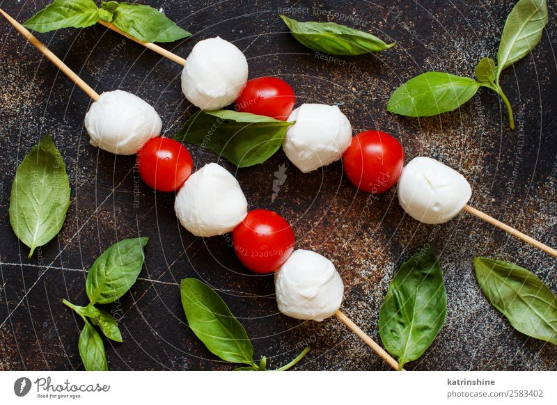 Italian cheese mozzarella with tomatoes and basil Nutrition Vegetarian diet Ball Dark Fresh Bright Delicious Soft Green Red White Tradition Meal mediterranean