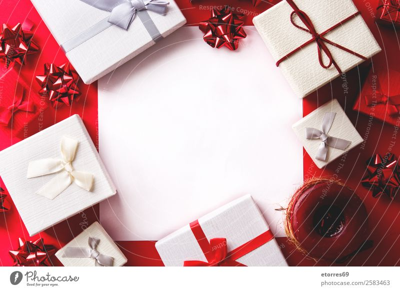 white and red gift on red background. Copyspace White Gift Christmas & Advent Box Red Neutral Background Background picture String Feasts & Celebrations Bow