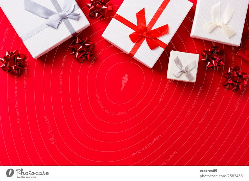 Red and white gift on red background. Copyspace Design Vacation & Travel Decoration Feasts & Celebrations Christmas & Advent Package Box Bow Ornament String
