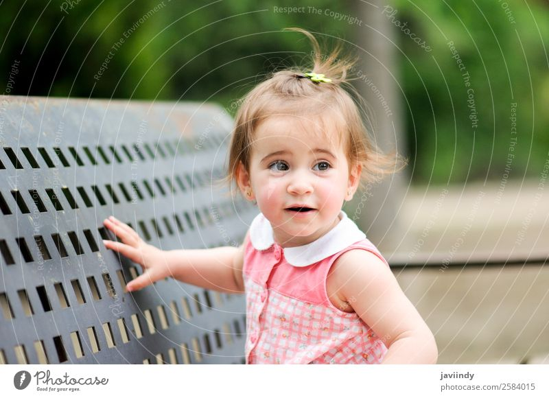 Adorable little girl playing in a urban park Lifestyle Joy Happy Beautiful Leisure and hobbies Playing Summer Child Human being Baby Toddler Girl Infancy 1